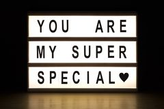 You are my super special light box. Sign board on wooden table royalty free stock photo