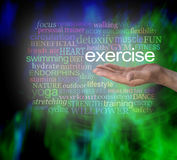 You Need Exercise word cloud. Male hand palm facing up with the word EXERCISE floating above surrounded by a relevant word cloud on a modern vibrant green and Stock Photo