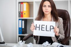 European tired and frustrated woman working as secretary in stre. You need help ? The beautiful business woman at office asks of the help Stock Photo