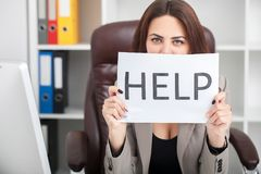You need help ? The beautiful business woman at office asks of t. He help Royalty Free Stock Image