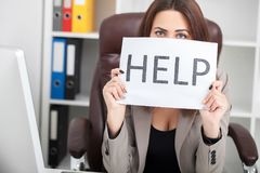 You need help ? The beautiful business woman at office asks of t. He help Stock Photo