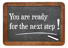 You are for the next step!. You are for the next step - motivational statement  on a vintage slate blackboard Stock Photography