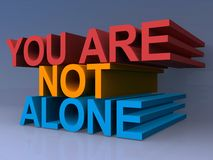 You are not alone. 3D text graphic you are not alone in red, orange and blue on purple background Stock Photos
