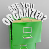 Are You Organized Filing Cabinet Words Records File System. The words Are You Organized and quesiton mark coming out of a green metal filing cabinet to Royalty Free Stock Images