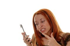 You piss me off. Young red head pointing at a cell phone Royalty Free Stock Image