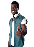 You play great music. Keep up. Black music lover showing thumbs up to camera Royalty Free Stock Photos