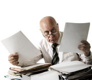 At you a problem with documents!. Ahgry elderly official with documents stock image