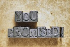 You promised. Exclamation made from metallic letterpress type Stock Photo