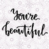 You're beautiful. Vector hand lettering on beauty floral background Stock Photography