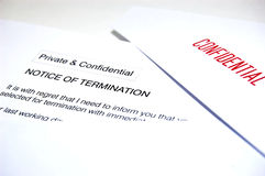You're fired!. Close up of a horrid letter that we may all receive one day. Differential focus on the word TERMINATION. Shallow DOF. Sharp relief with shadow for royalty free stock image