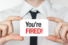 You're fired card. Business man holding a card with you're fired text Stock Images