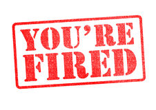 YOU`RE FIRED Rubber Stamp. Over a white background Stock Photography