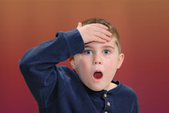You're Kidding. Young boy with hand to head with surprised expression Royalty Free Stock Photography
