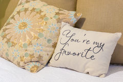 You're my favorite. A cute pillow on a simple bed royalty free stock photo