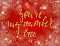 You`re my number one Hand drawn creative calligraphy and brush pen lettering on gold background with bokeh. Stock Image