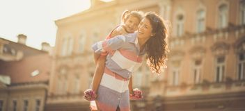 You`re always safe on your mother`s back. stock images