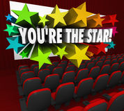 You're the Star Movie Theatre Screen Film Acting. The words You're the Star exploding out of a movie theatre screen to illustrate celebrity and being a hot actor Stock Photo