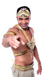 Are you ready for the carnival ?. Handsome male samba dancer pointing forward over white Royalty Free Stock Photography