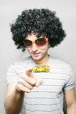 Are you ready for disco?. Funny guy in afro curly wig with eyeglasses and ribbon bow-tie pointing with his finger stock photography