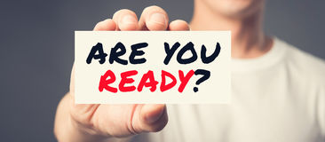 ARE YOU READY? message on the card shown by a man Royalty Free Stock Images