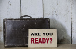 Are You Ready? Old travel suitcase on a shelf garage Stock Photos