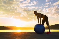Are you ready to exercise. Beautiful girl is preparing to exercise by the water Royalty Free Stock Photo