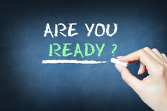 """Are you ready?"" written on a black board. ""Are you ready?"" written in white chalk on a black board royalty free stock photo"