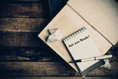 Are you ready written on the paper on a wood background. Royalty Free Stock Image