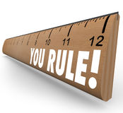 You Rule Ruler Praise Compliment Good Review. The words You Rule on a ruler to illustrate good or grate grades, review, approval, praise, commendation or Stock Photos