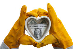 You are in safe hands, my Love... Two hands in protective gloves hold ceramic heart with a dollar bill inside, isolated on white Royalty Free Stock Photos