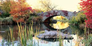 Gapstow bridge in Central Park. When you see this bridge, inside feeling tells you that somewhere around you should see fairy tail characters too royalty free stock photography