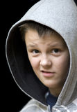Are you serious?. Portrait of a teenage boy wearing a hood, the look of disbelief over his face. Other expressions available Stock Photo