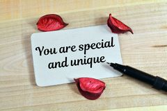 You are special and unique. Text write in card on wood royalty free stock photography