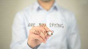 Are You Spying On Me ?, man writing on transparent screen royalty free stock images