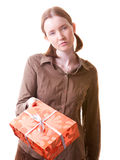 You still want that present?. Irritated girl giving present box to somebody Royalty Free Stock Photo