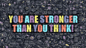 You are Stronger than You Think on Dark Brick Wall. Multicolor Concept - You are Stronger than You Think on Dark Brick Wall with Doodle Icons. You are Stronger Royalty Free Stock Photo