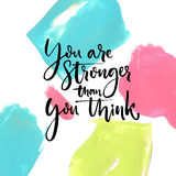 You are stronger than you think. Motivational saying at artistic paint strokes background Stock Images