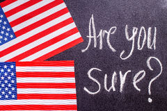 Are you sure  on the chalk board and US flag Royalty Free Stock Image