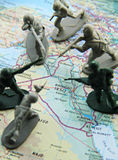 You are surround. Toy soldiers in a concept of attacking and surrounding iraq Stock Images