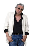 You talking to me?. Mature man wearing a white tuxedo and sunglasses standing and looking at the camera Stock Images
