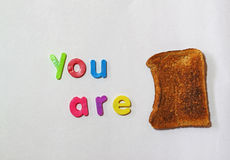 You are toast, or finished or in trouble. Metaphor. Words you are and a piece of toast. You are toast, meaning you are finished or you are in trouble. A well Stock Image