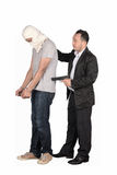 You are under arrest. Police men arrested suspect man, He was arrested for theft and fraud Royalty Free Stock Photo