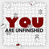 You Are Unfinished Incomplete Imperfect Puzzle Pieces Improvemen. You Are Unfinished words on puzzle pieces to illustrate self improvement and acceptance of your Royalty Free Stock Photo