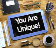 You Are Unique Concept on Small Chalkboard. 3D. Stock Photos