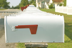 You've Got Mail. A long row of mailboxes on a quiet street Royalty Free Stock Photography