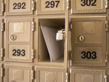 You've got mail. Letters in an open mailbox in a wall of mailboxes royalty free stock photo