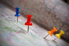 You& x27;ve Reached Your Destination. Close-up shot of thumbtacks marking destinations in an atlas Royalty Free Stock Photo