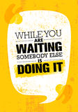 While You Are Waiting Somebody Else Is Doing It. Inspiring Creative Motivation Quote Poster Template. Vector Typography Banner Design Concept On Grunge Texture Stock Image