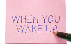 When you wake up written on remember note Royalty Free Stock Photos