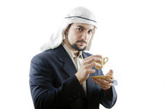 You want arab infusion for business?. Looking you in tea time an arab man Royalty Free Stock Images